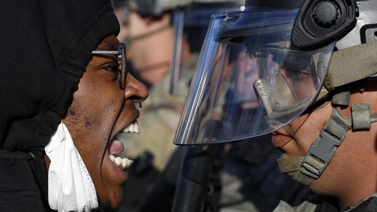 Protesters and National Guardsmen face off on East Lake Street, Friday, May 29, 2020, in St. Paul, Minn. (AP Photo / John Minchillo)