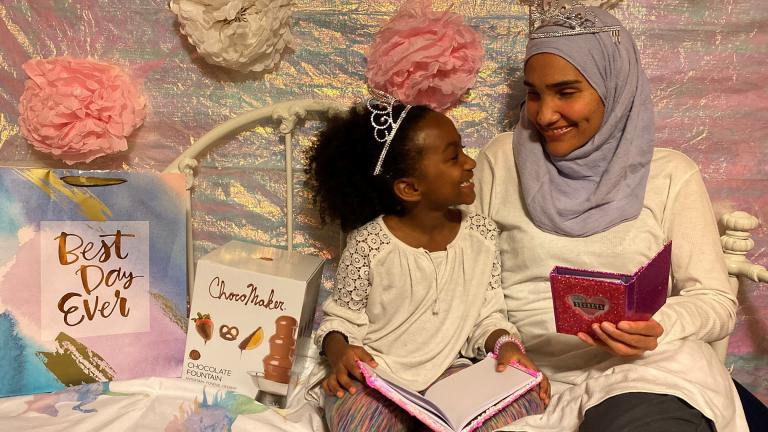 This undated photo shows Melissa Mueller-Douglas and her 7-year-old daughter, Nurah, at their home in Rochester, N.Y. with some of the items they plan to use for a Mother's Day sleepover. (Yakub Shabazz via AP)