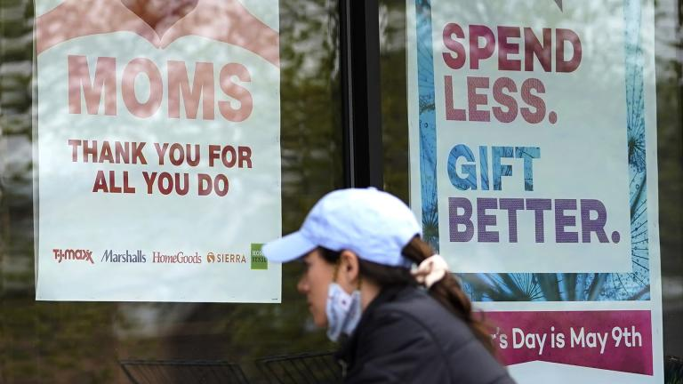 Signs about Mother's Day are displayed at a home decor department store in Northbrook, Ill., Saturday, May 8, 2021. (AP Photo / Nam Y. Huh)