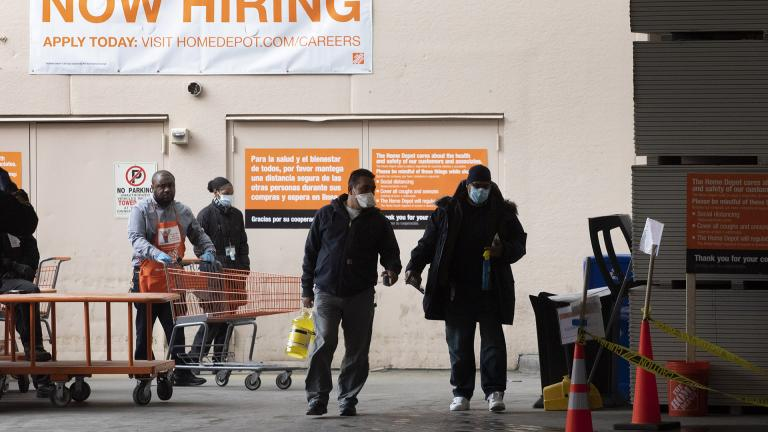Home Depot customers carry their purchases as they leave the store, Friday, April 3, 2020 during the coronavirus pandemic in New York. (AP Photo / Mark Lennihan)