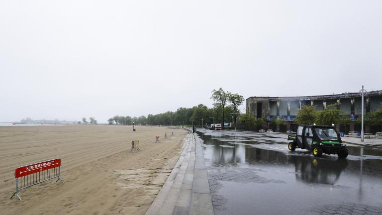 New York City Parks officials work at an empty Orchard Beach Saturday, May 23, 2020, in the Bronx borough of New York. (AP Photo / Frank Franklin II)