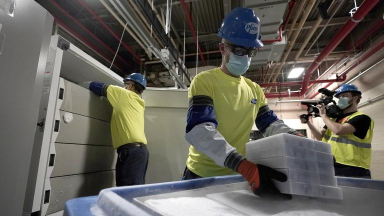 Boxes containing the Pfizer-BioNTech COVID-19 vaccine are prepared to be shipped at the Pfizer Global Supply Kalamazoo manufacturing plant in Portage, Mich., Sunday, Dec. 13, 2020. (AP Photo / Morry Gash, Pool)