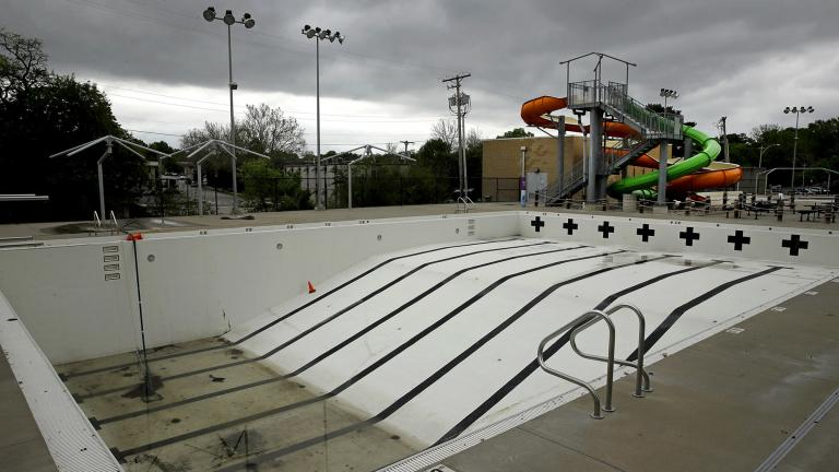 In this photo taken Friday, May 15, 2020, the public pool in Mission, Kan. is lifeless as plans remain in place to keep the pool closed for the summer to help prevent the spread of COVID-19. (AP Photo / Charlie Riedel)