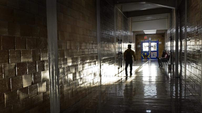 A student walks between classes at Wyandotte High School in Kansas City, Kan., on the first day of in-person learning Wednesday, March 30, 2021. (AP Photo / Charlie Riedel)