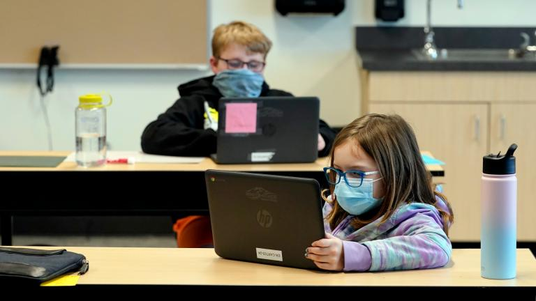 In this Feb. 2, 2021, file photo, students wear masks as they work in a fourth-grade classroom, at Elk Ridge Elementary School in Buckley, Wash. (AP Photo / Ted S. Warren, File)