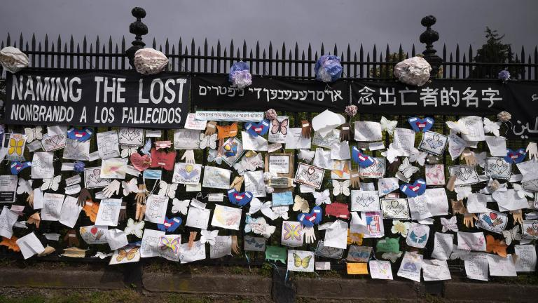 In this Thursday, May 28, 2020 file photo, a fence outside Brooklyn's Green-Wood Cemetery is adorned with tributes to victims of COVID-19 in New York. (AP Photo / Mark Lennihan)