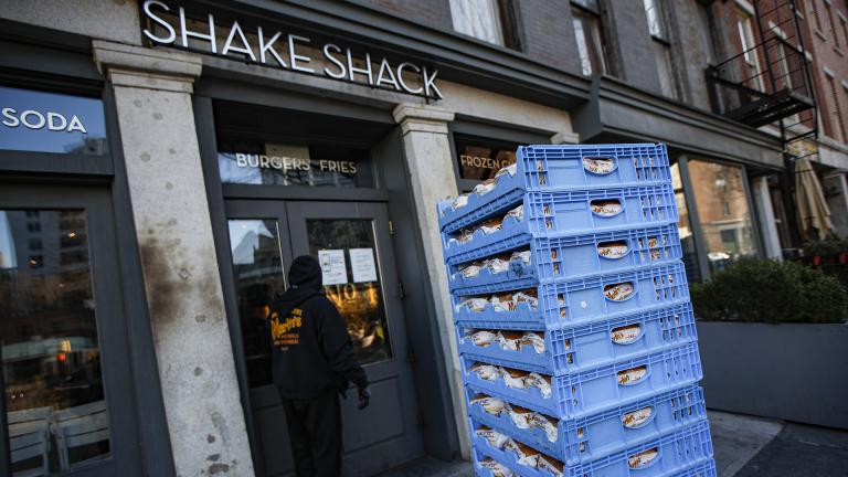 In this March 16, 2020, file photo, a bread delivery is made to a Shake Shack restaurant in the Brooklyn borough of New York. (AP Photo / John Minchillo, File)