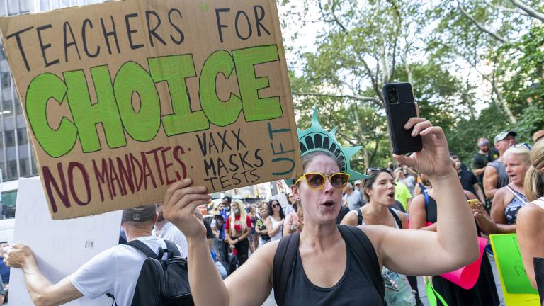 Teachers rally at a demonstration against COVID-19 vaccination mandates, Wednesday, Aug. 25, 2021, in New York. (AP Photo / Mary Altaffer)