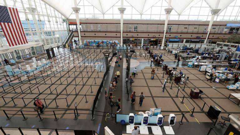 Travelers make their ways to the south security checkpoint in the main terminal of Denver International Airport Wednesday, July 22, 2020, in Denver. (AP Photo / David Zalubowski, File)