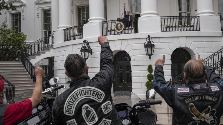 """President Donald Trump speaks during a """"Rolling to Remember Ceremony,"""" to honor the nation's veterans and POW/MIA, from the Truman Balcony of the White House, Friday, May 22, 2020, in Washington. (AP Photo / Alex Brandon)"""