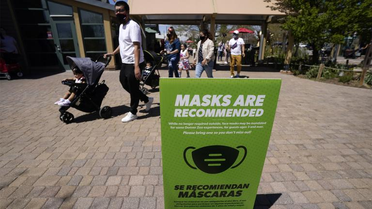 FILE - In this May 13, 2021, file photo, although no longer required outside, a sign advises visitors to wear masks at the Denver Zoo in Denver. (AP Photo / David Zalubowski, File)