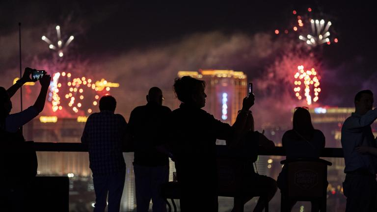In this Sunday, July 4, 2021, file photo, spectators watch as fireworks explode over the Las Vegas Strip during a 4th of July Fireworks show in Las Vegas. (AP Photo / John Locher, File)