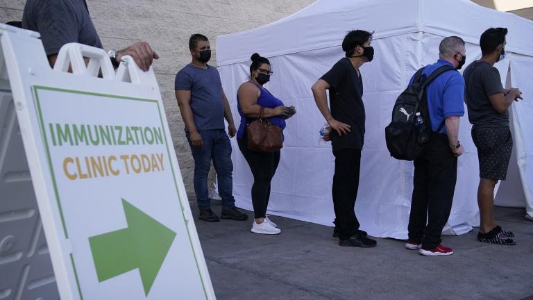 In this Wednesday, July 7, 2021, file photo, people wait in line for COVID-19 vaccinations at an event at La Bonita market, a Hispanic grocery store, in Las Vegas. (AP Photo / John Locher, File)