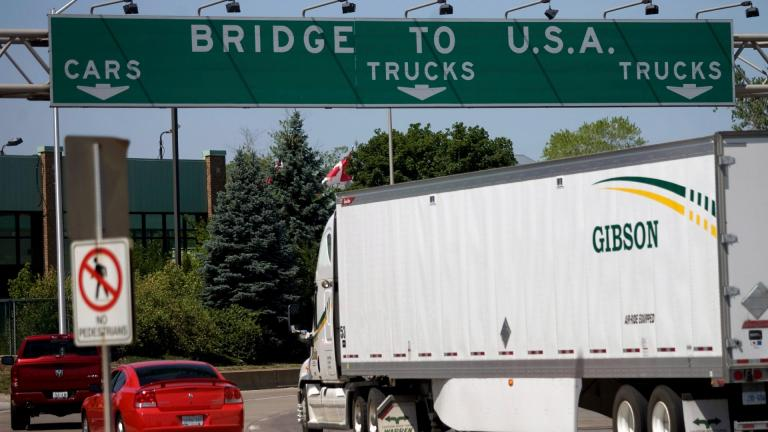 In this Friday June 15, 2012 file photo, Motorists make their way to Ambassador Bridge connecting Canada to the United States in Windsor, Ontario. (Mark Spowart / The Canadian Press via AP, File)
