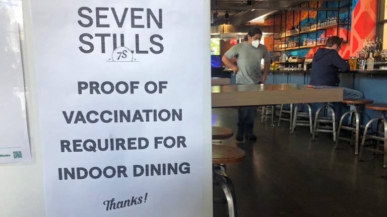 A proof of vaccination sign is posted at a bar in San Francisco on Thursday, July 29, 2021. (AP Photo / Haven Daley)