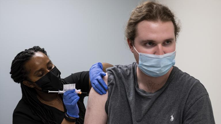 Cole Smith receives a Moderna variant vaccine shot from clinical research nurse Tigisty Girmay at Emory University's Hope Clinic, on Wednesday afternoon, March 31, 2021, in Decatur, Ga. (AP Photo / Ben Gray)