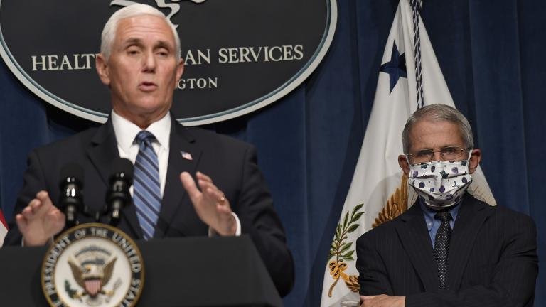 Dr. Anthony Fauci, right, director of the National Institute of Allergy and Infectious Diseases, listens as Vice President Mike Pence speaks during a news conference with the Coronavirus task force at the Department of Health and Human Services in Washington, Friday, June 26, 2020. (AP Photo / Susan Walsh)