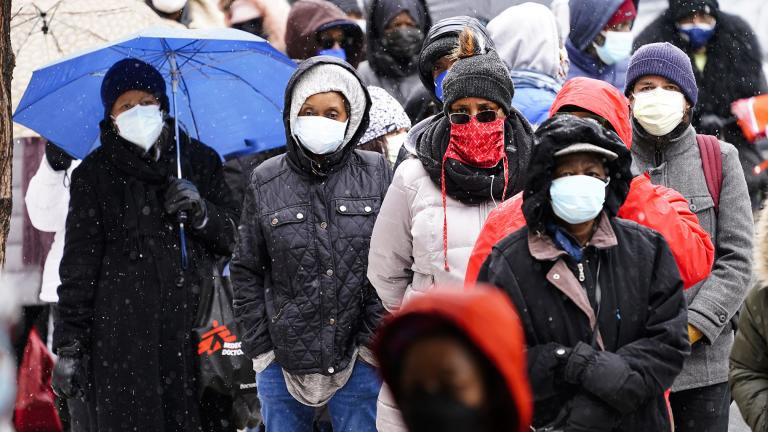In this Feb. 19, 2021, file photo, people wait in line at a 24-hour, walk-up COVID-19 vaccination clinic hosted by the Black Doctors COVID-19 Consortium at Temple University's Liacouras Center in Philadelphia. (AP Photo / Matt Rourke, File)