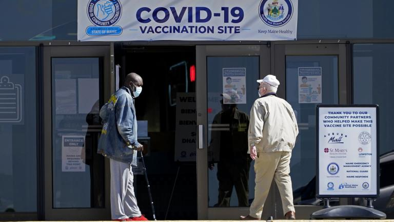 In this May 12, 2021, file photo, one man holds the door for another as they arrive at a COVID-19 vaccination clinic at the Auburn Mall in Auburn, Maine. (AP Photo / Robert F. Bukaty)