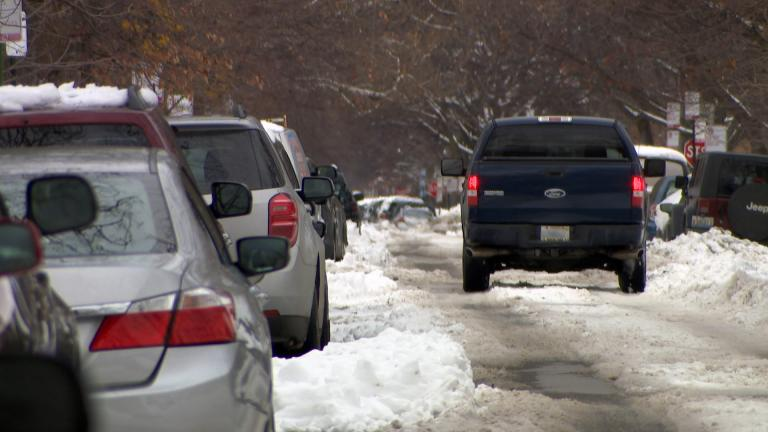 A snow-covered street in Chicago on Tuesday, Feb. 2, 2021 remains following a winter storm that blanketed parts of the area with more than a foot of snow over the weekend. (WTTW News)