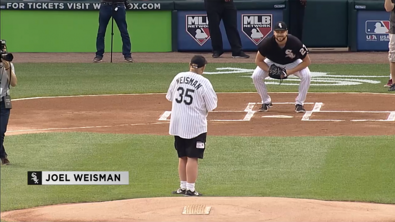 "Former ""Chicago Tonight: The Week in Review"" host Joel Weisman throws out the first pitch Monday, Aug. 6, 2018."