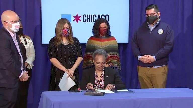 Mayor Lori Lightfoot signs a law designed to expand protections for undocumented immigrants. (Chicago Mayor's Office / Twitter)