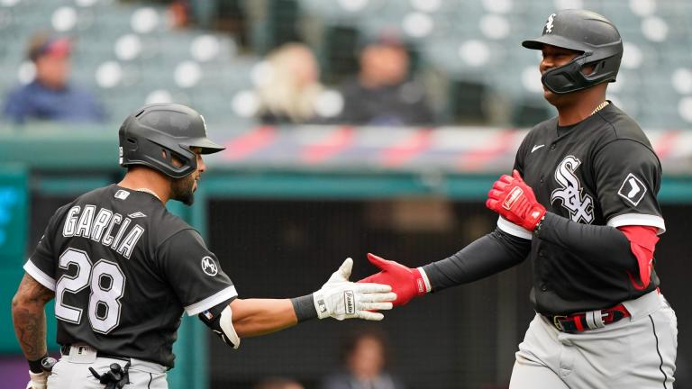 Chicago White Sox's Eloy Jimenez, right, celebrates with Leury Garcia after Jimenez hit a solo home run in the second inning in the first baseball game of a doubleheader against the Cleveland Indians, Thursday, Sept. 23, 2021, in Cleveland. (AP Photo / Tony Dejak)