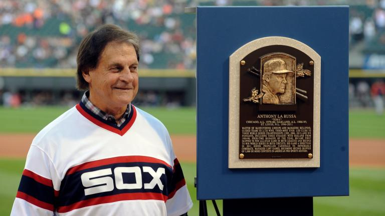 In this Aug. 30, 2014, file photo, former Chicago White Sox manager Tony La Russa stands with his Baseball Hall of Fame plaque before the second baseball game of a doubleheader against the Detroit Tigers in Chicago. (AP Photo / Matt Marton, File)
