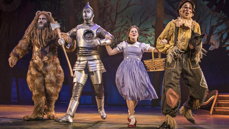 "From left: Paul-Jordan Jansen, Carl Draper, Elizabeth Stenholt, Kyle Adams and Nessa (as Toto) in Paramount Theatre's ""The Wizard of Oz."" (Photo credit: Liz Lauren)"