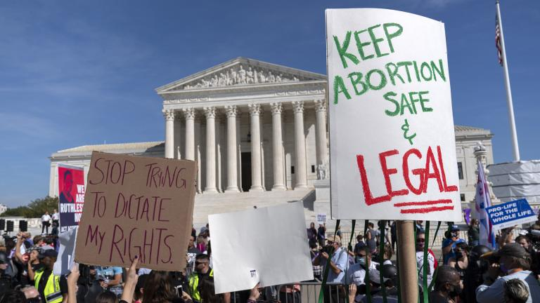 Demonstrators march outside of the the U.S. Supreme Court during the Women's March in Washington, Saturday, Oct. 2, 2021. (AP Photo / Jose Luis Magana)