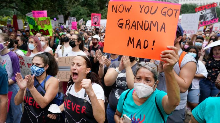 People participating in the Houston Women's March against Texas abortion ban listen to speakers at City Hall Saturday, Oct. 2, 2021, in Houston. (Melissa Phillip / Houston Chronicle via AP)