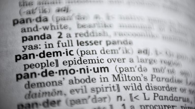 "In this Saturday, Nov. 21, 2020, photo the word pandemic is displayed in a dictionary in Washington. Merriam-Webster on Monday announced ""pandemic"" as its 2020 word of the year. (AP Photo / Jenny Kane)"