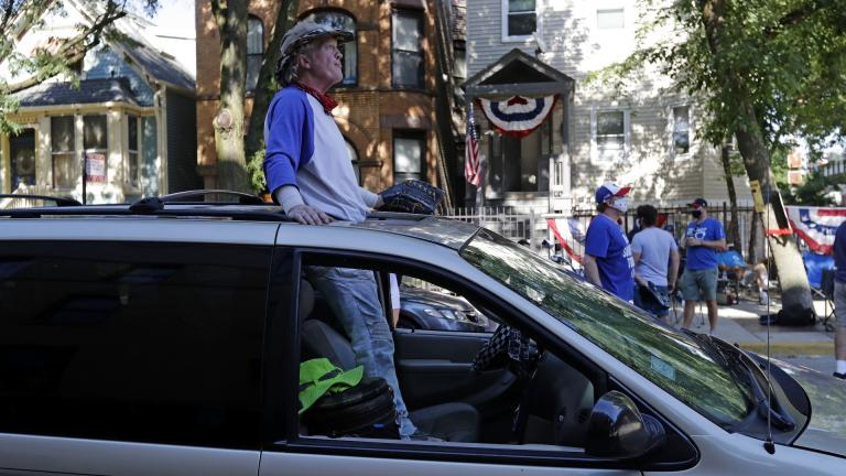 Chicago Cubs fans wait for a ball outside of Wrigley Field before the Opening Day baseball game between the Chicago Cubs and the Milwaukee Brewers in Chicago, Friday, July 24, 2020, in Chicago. (AP Photo / Nam Y. Huh)