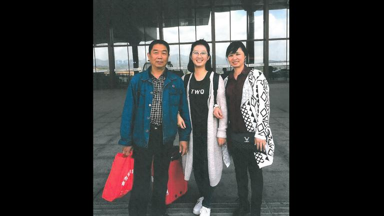 Yingying Zhang, center, stands with her parents at a train station in China in 2017. This marked the last time they saw their daughter alive. (U.S. Attorney's Office)
