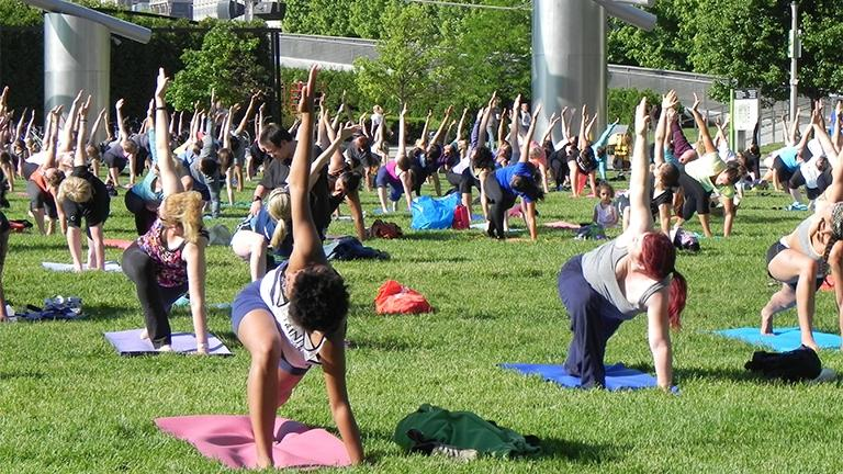 Free summer workout classes, including yoga, return to Millennium Park in June. (Courtesy of the city of Chicago Department of Cultural Affairs and Special Events)