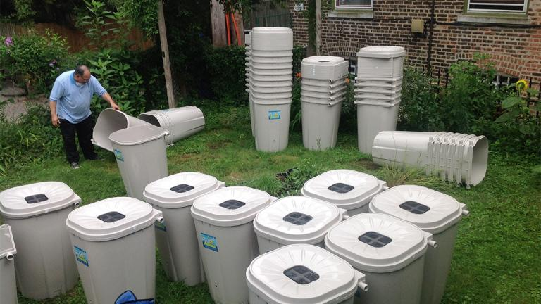 The Metropolitan Water Reclamation District provided 500 rain barrels for the environmental organization Faith in Place to distribute. (Ramont Bell)