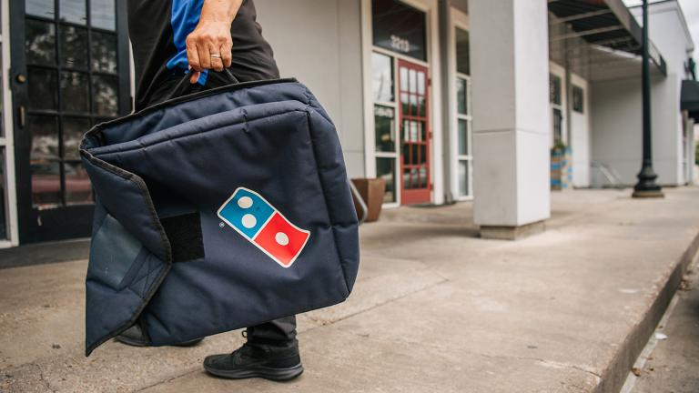 Domino's Pizza is taking on delivery apps that charge extra fees with a new giveaway totaling $50 million worth of free food. (Brandon Bell / Getty Images)