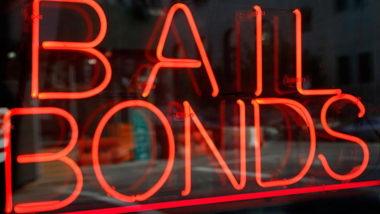 This file photo shows a sign advertising a bail bonds business in the Brooklyn borough of New York. (Kathy Willens / AP)