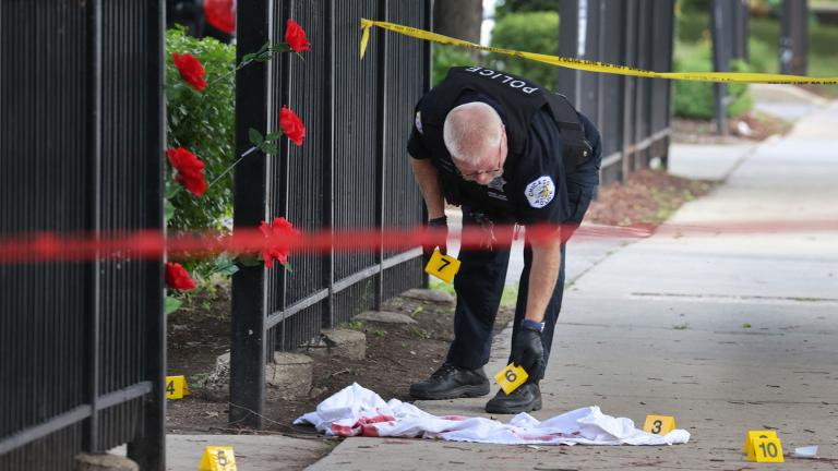 Police investigate a crime scene where three people were shot — one fatally — in the Bridgeport neighborhood on June 23 in Chicago. (Scott Olson / Getty Images)