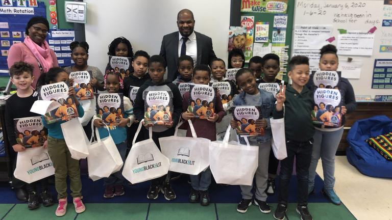 An elementary class in Evanston, Illinois, receives free books from the nonprofit Young, Black & Lit, whose mission is to give away books with Black main characters. (Courtesy of Young, Black & Lit)