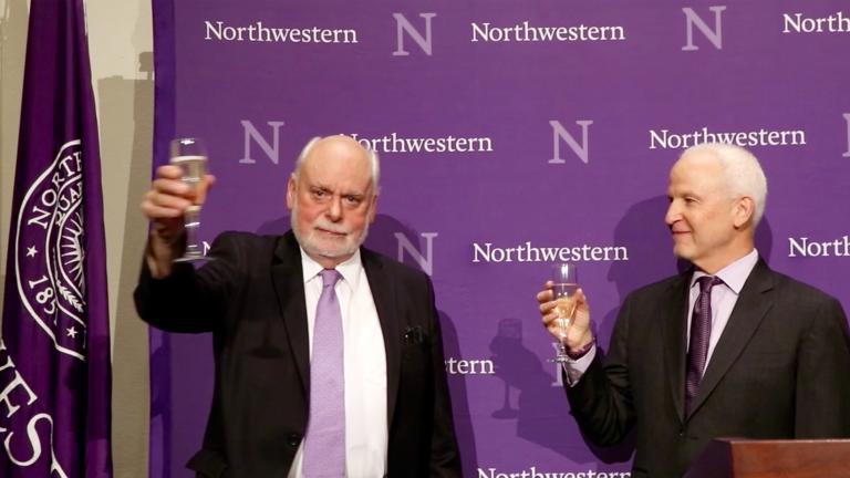 Northwestern University chemistry professor Sir Fraser Stoddart, left, raises his glass at a ceremony celebrating his Nobel Prize win. (Evan Garcia / Chicago Tonight)