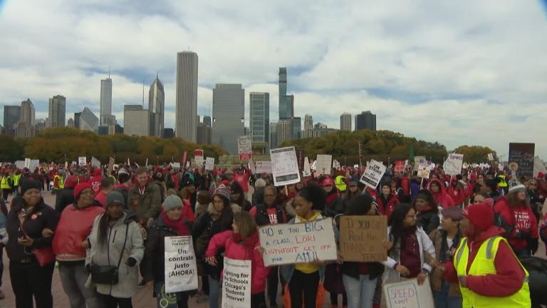 Members of the Chicago Teachers Union gathered for a rally at Buckingham Fountain on Friday afternoon, the seventh day of their ongoing strike. (WTTW News)