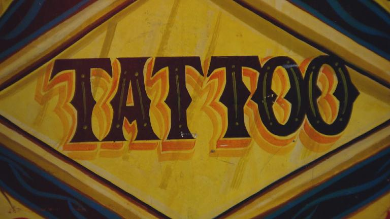 """A sign spotted at the Field Museum's new """"Tattoo"""" exhibition. (Chicago Tonight)"""