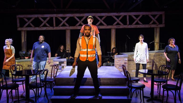 "Kiersten Frumkin (left to right), Jared David Michael Grant, Stephen Blu Allen, Michael Kingston, Loretta Rezos and Cynthia F. Carter in ""Working."" Background, in band are Perry Cowdery (left to right), Jeremy Ramey and Rafe Bradford. (Photo by Austin Oie Photography)"