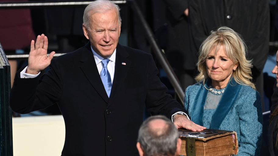 Joe Biden is sworn in as the 46th president of the United States by Chief Justice John Roberts as Jill Biden holds the Bible during the 59th Presidential Inauguration at the U.S. Capitol in Washington, Wednesday, Jan. 20, 2021. (Saul Loeb / Pool Photo via AP)