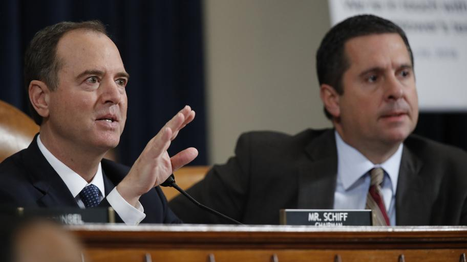 House Intelligence Committee Chairman Adam Schiff, D-Calif., left, and ranking member Rep. Devin Nunes, R-Calif., right, talk to Jennifer Williams, an aide to Vice President Mike Pence, and National Security Council aide Lt. Col. Alexander Vindman, during testimony before the House Intelligence Committee on Capitol Hill in Washington, Tuesday, Nov. 19, 2019, during a public impeachment hearing of President Donald Trump's efforts to tie U.S. aid for Ukraine to investigations of his political opponents. (AP P