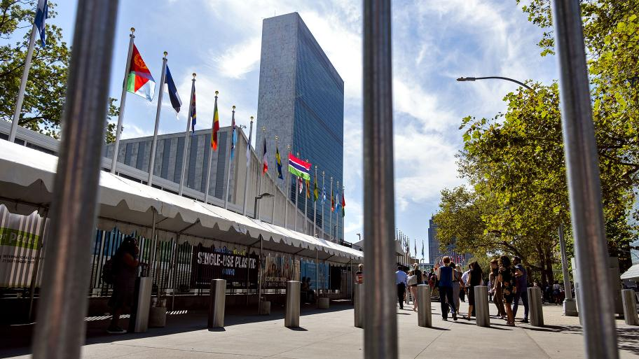 Seen through the bars of a temporary security barrier, people walk along 1st Avenue in New York in front of United Nations Headquarters as the United Nations General Assembly gets underway Saturday, Sept. 21, 2019 and into the coming week. (AP Photo / Craig Ruttle)