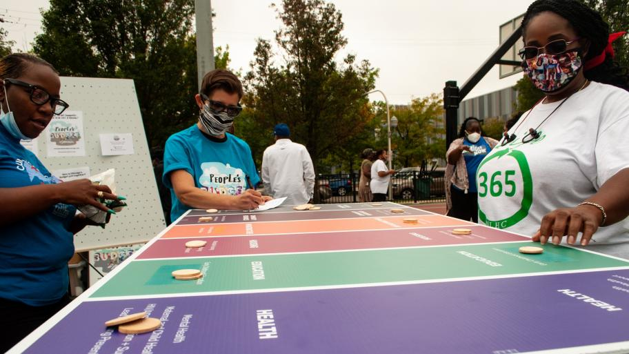 Community members participate in a budget game outlining their priorities Saturday, Sept. 26, 2020 in Austin's Moore Park. (Grace Del Vecchio / WTTW News)