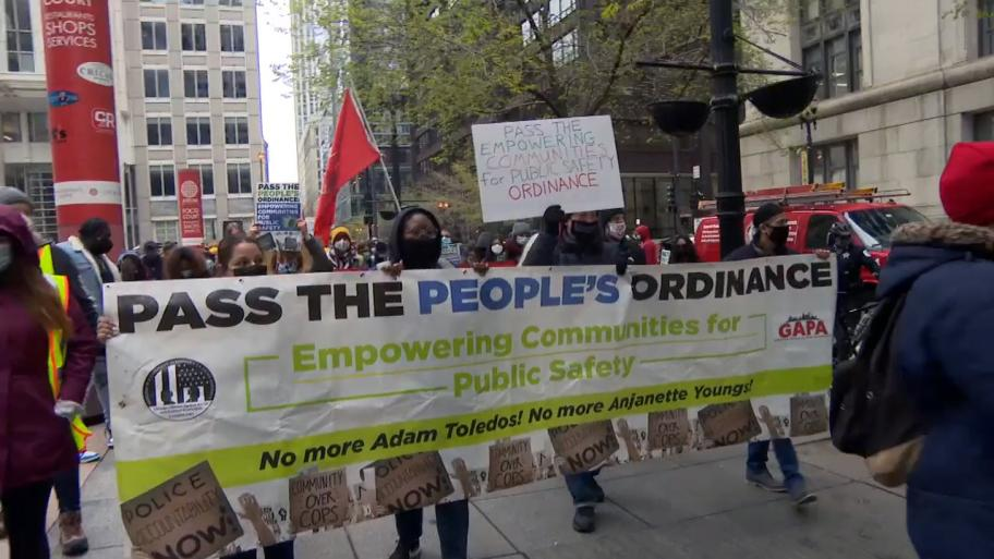 Supporters of the Empowering Communities for Public Safety plan call for more police accountability during a rally April 21, 2021. (WTTW News)