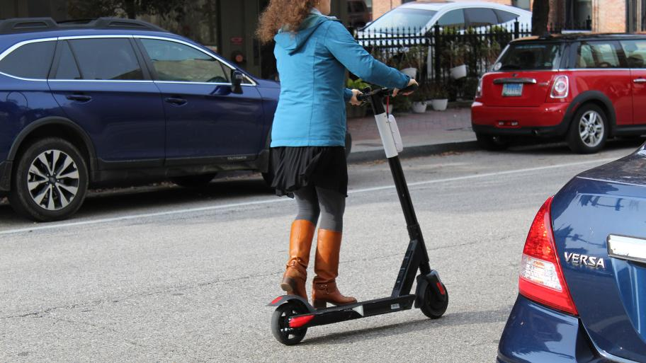 A woman rides an electric scooter in Baltimore on Nov. 18, 2018. (Elvert Barnes / Flickr)